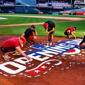 Arizona staff prepping the field for tonight's game