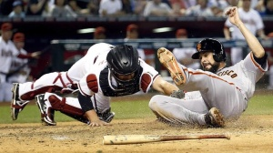 Vogey slides to score a run Tuesday night