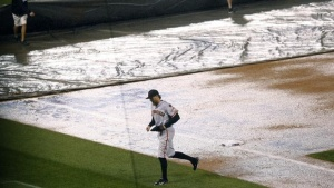 Hunter Pence leaves the Field Friday night after yet another rain delay